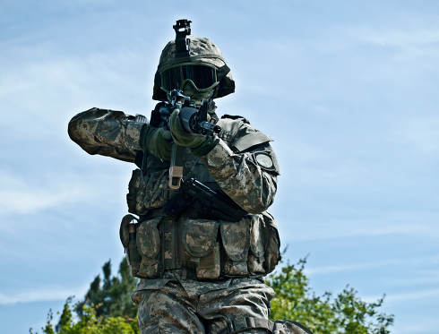 Attacking US soldier shooting his gun moving towards the camera