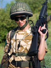 British girl soldier in desert uniform holding her rifle