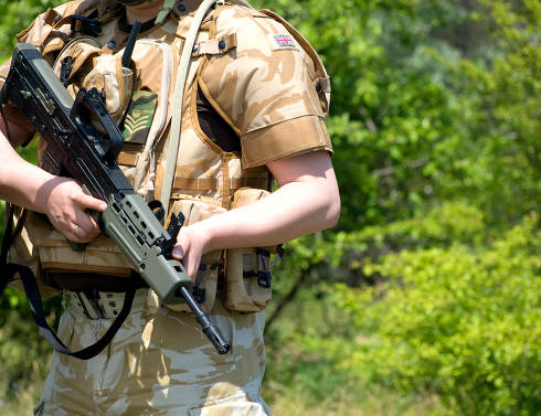 British Royal Commando in camouflage uniform holding his rifle