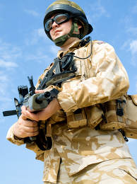British Royal Commando in desert uniform holding his rifle
