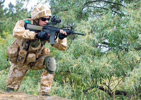British soldier in camouflage uniform in action