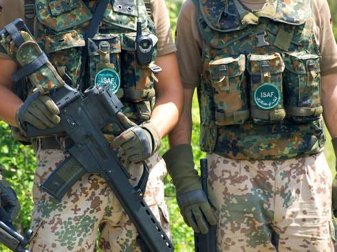 Bundeswehr soldiers in camouflage uniform holding their.rifles