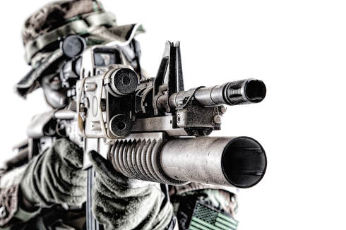 Close up studio shoot of modern commando soldier, US army marine riders shooter looking trough weapon optics, aiming service rifle with laser sight and grenade launcher isolated on white background