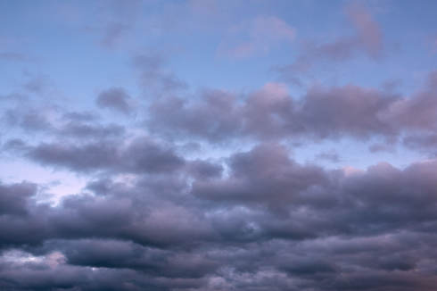 Early morning sky with pastel-colored clouds