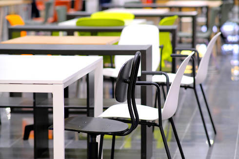Empty cafe tables, great design for your purposes. Pandemic and infection prevention. Interior design. Prevention of diseases. Dark background