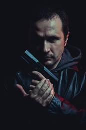 ganster, dangerous man with a gun, shooting
