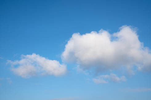 Low angle view to sky with cumulus clouds