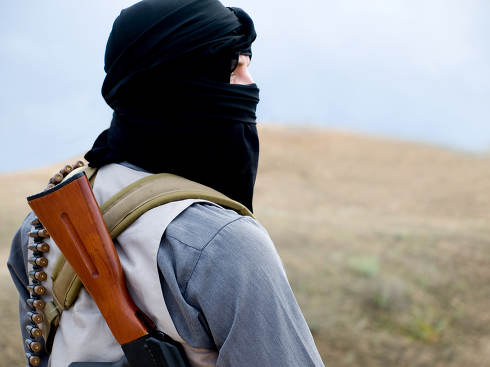 Muslim militant with rifle