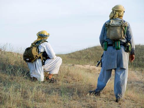 Muslim rebels with rifles