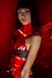 Oriental girl with red plastic costume, futuristic cosplay costu