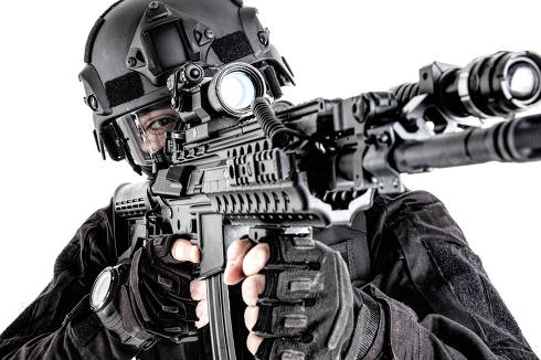 Police special operations fighter, quick reaction group shooter searching targets to shot, observing territory, aiming assault rifle with optical sight, close up studio portrait isolated on white