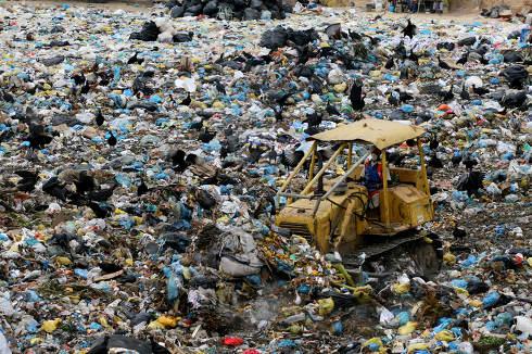 porto Seguro, bahia Brazil, may14, 2008, tractor is seen turning trash in the sanitary landfill of Porto Seguro.