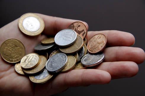 salvador, bahia Brazil, january 23, 2015, Hand holds Real coins, Brazilian money.