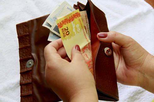 salvador, bahia Brazil, january 23, 2015, Woman hands counting Real, Brazilian money banknotes.