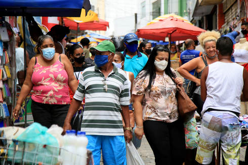 salvador, bahia, brazil-february 8, 2021: Movement of people wearing protective masks against the coronavirus at a popular shopping location in downtown Salvador.