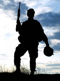 Silhouette of US soldier with rifle against a sunset