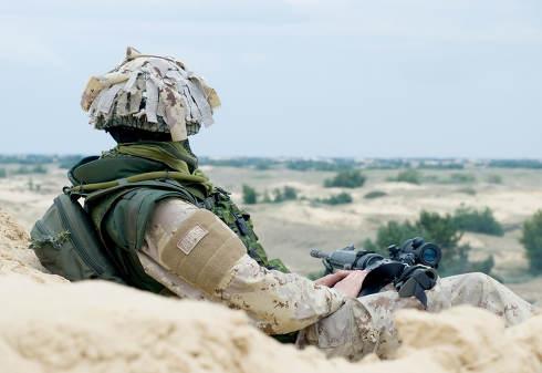 soldier in desert uniform at rest