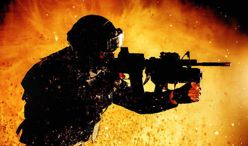 Special forces fighter, counter terrorist team shooter aiming assault rifle with grenade launcher, shooting in firefight, breaking through fire on battlefield, rushing on enemies, attacking targets
