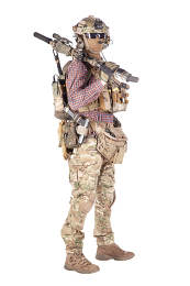 Strikeball enthusiast in checkered shirt wearing military ammunition, face mask, helmet and radio headset, tactical glasses, camo pants, armed service rifle and handgun studio shoot isolated on white