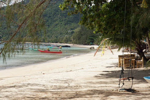 Thailand, the empty Sairee Beach and longtail boats at the island named Koh Tao in Thailand April 30, 2021, a rainy afternoon
