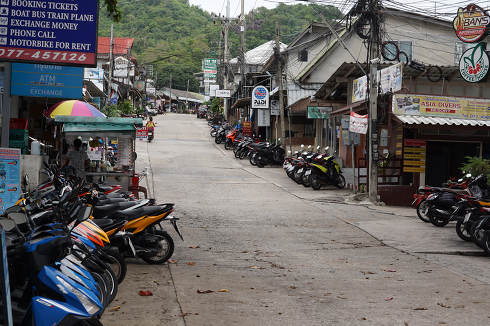 The empty road with no people for arrivals and departures away from the Mae Haad Pier at May 8, 2021, in Koh Tao Thailand