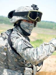 US soldier in camouflage uniform wearing helmet