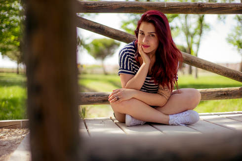 wooden rustic bridge, spring scene, red haired girl with straw h