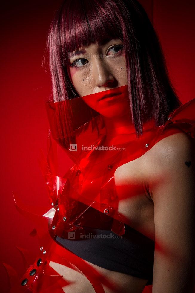 Anime, Oriental girl with red plastic costume, futuristic cospla