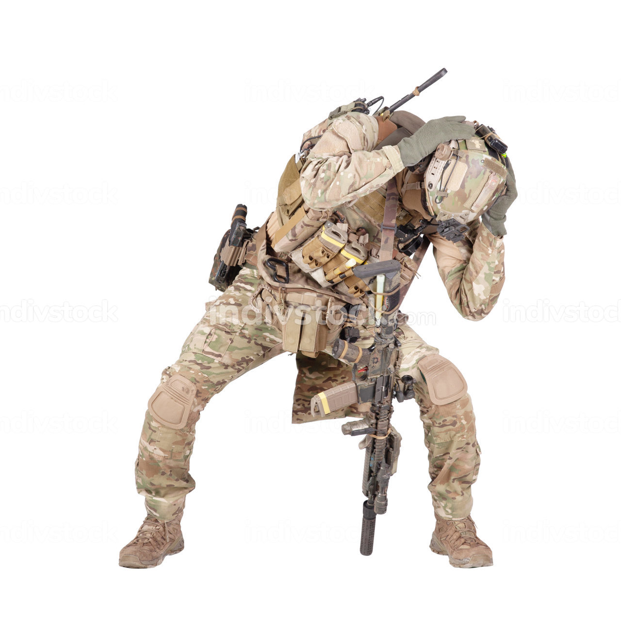 Armed infantryman in camo uniform and helmet embracing head with hands, covering himself from grenade, mine or air bomb explosion, artillery strike danger studio shoot isolated on white background