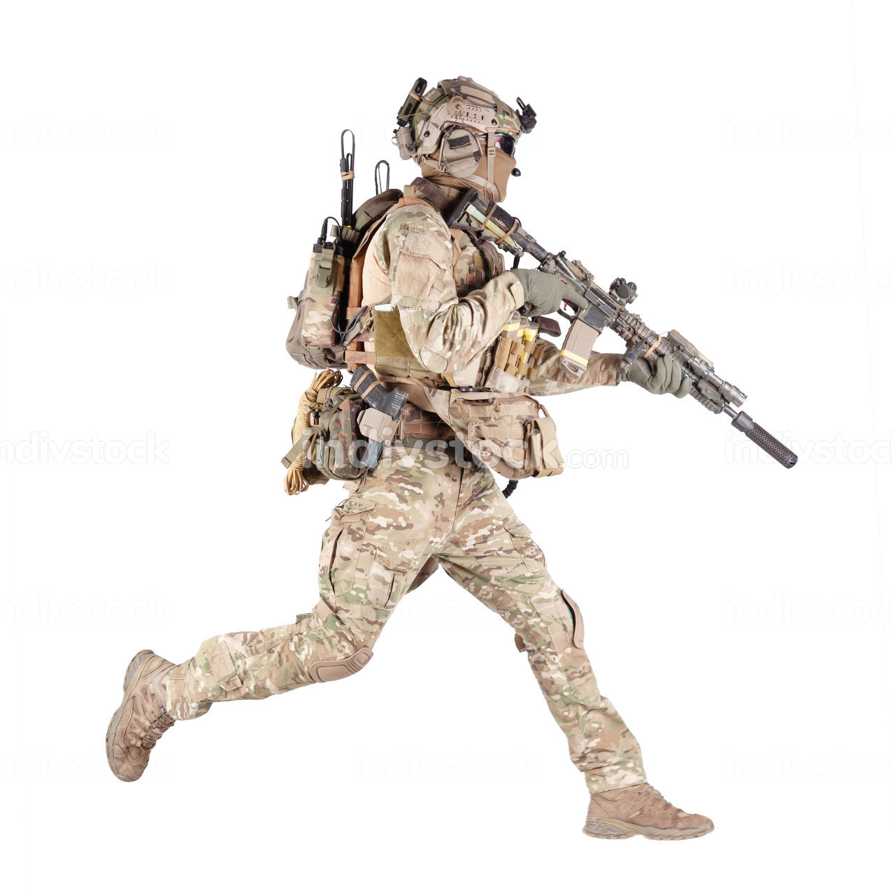 Army soldier, equipped infantryman, airsoft player in camouflage battle uniform, helmet and tactical radio headset jumping, running with assault rifle in hand studio shoot isolated on white background