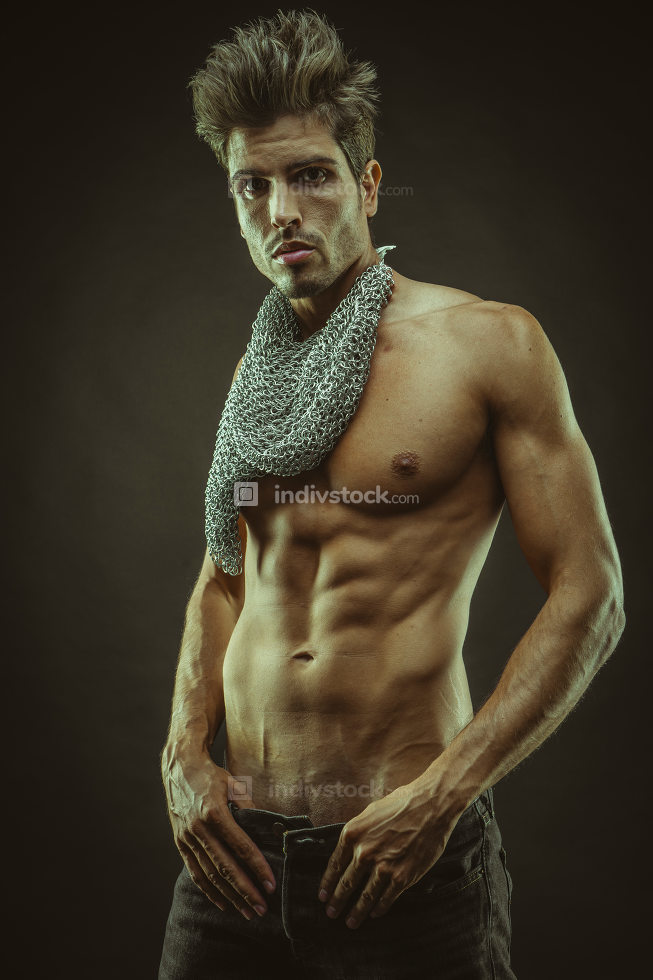 Bodybuilding, Elegant and muscular man with naked torso and chai