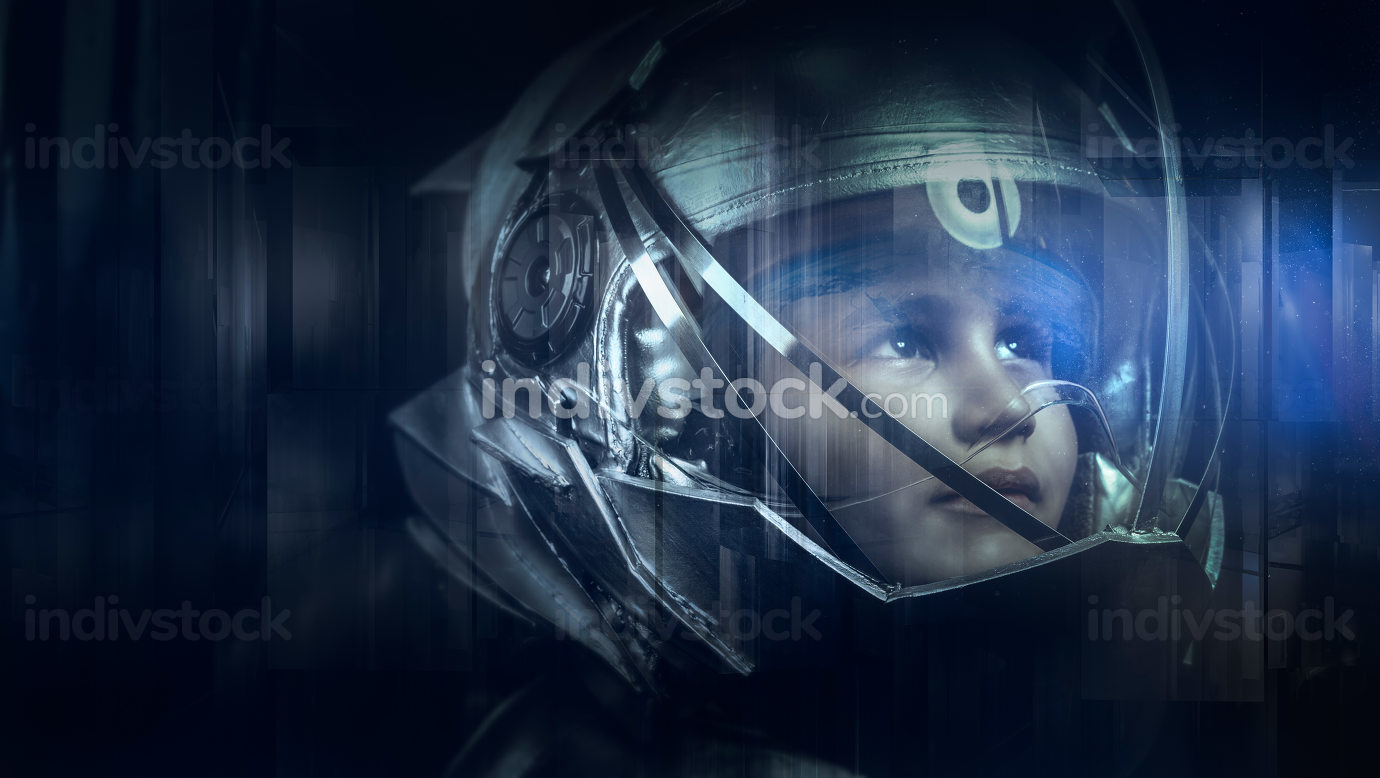 Boy playing to be an astronaut with space helmet and metal suit