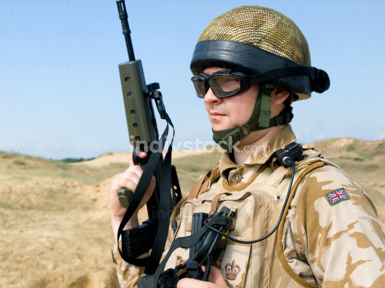 British Royal Commando in desert uniform holding his rifle