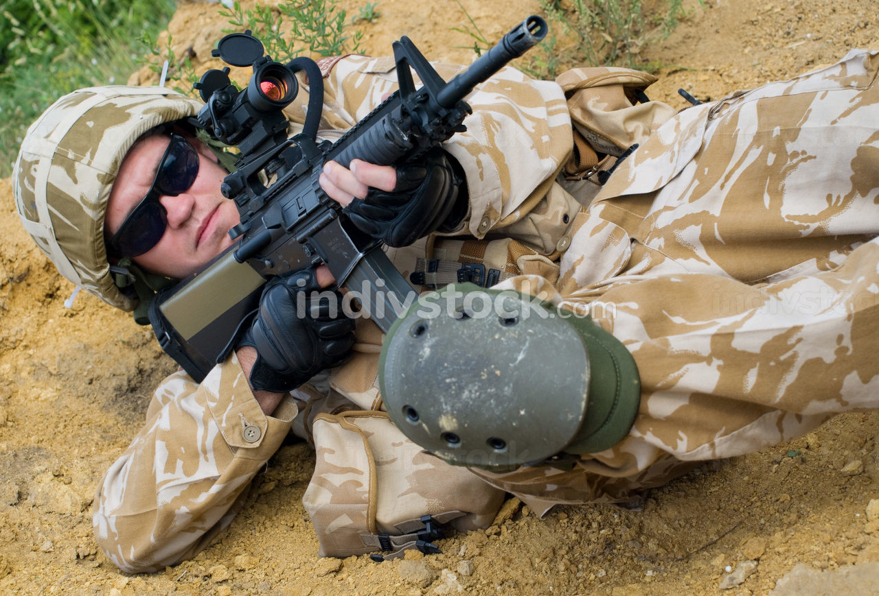 British soldier in desert uniform in action