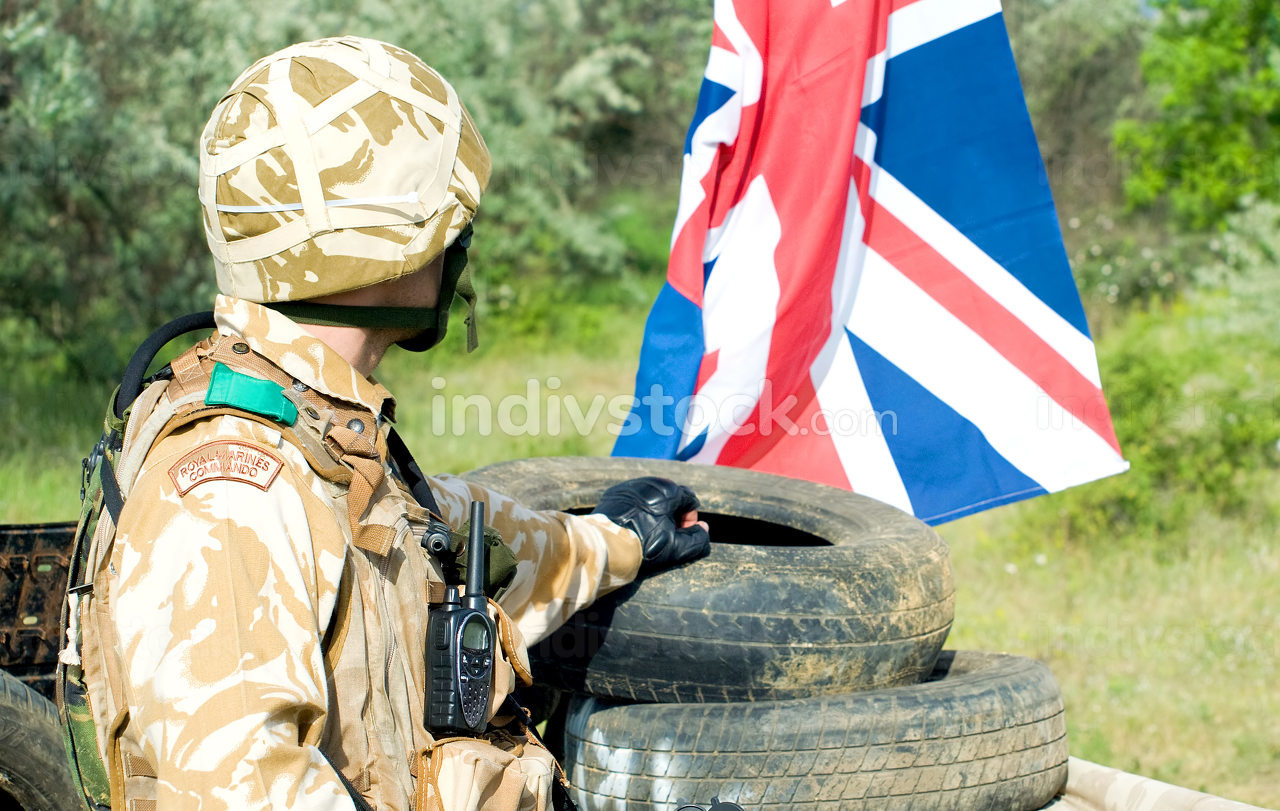 british soldier with the UK flag at the checkpoint