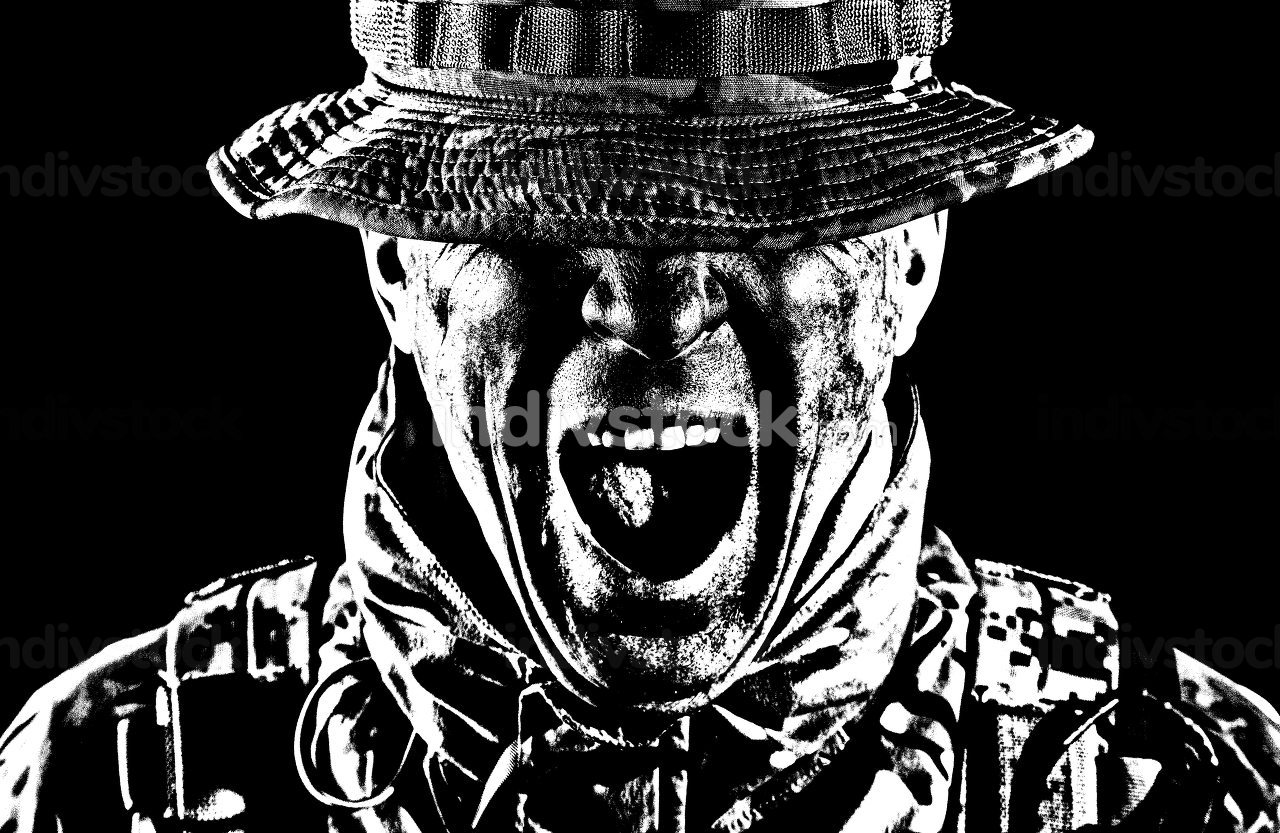 Commando fighter, elite troops soldier in camo uniform, bending head, hiding eyes behind bonnie hat, clenching teeth with anger and aggression, low key, studio portrait isolated on black background