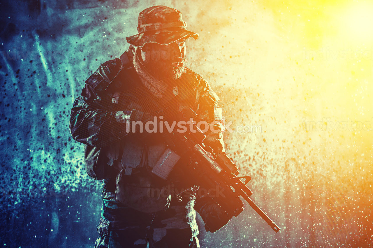 Commando fighter, professional mercenary, special forces soldier with camouflaged face, loaded with ammunition, armed assault rifle, patrolling on secret mission, sneaking in darkness ready to fight
