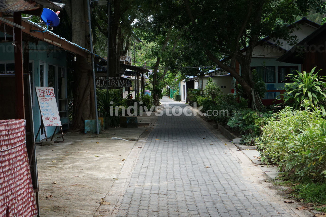 empty and quiet, the first street, beach road along the beach, named Sairee beach at the island Koh Tao, Thailand, May 8, 2021