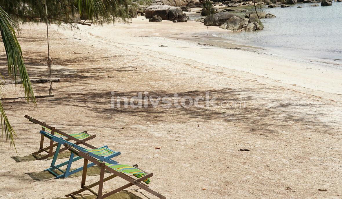 empty beach, sun loungers or deck chairs on a sandy beach in Koh Tao, Thailand