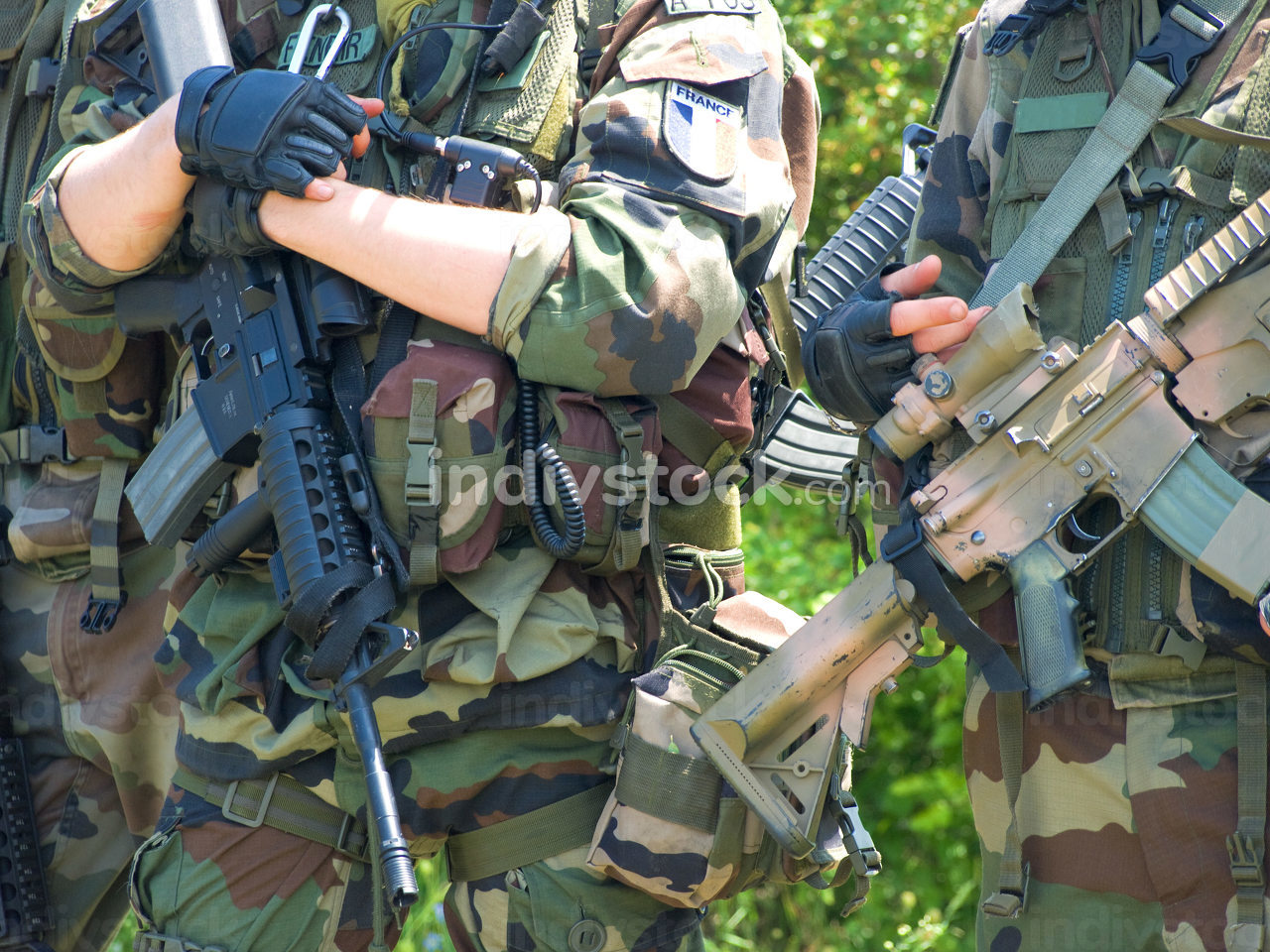 French soldiers in camouflage uniform holding their rifles