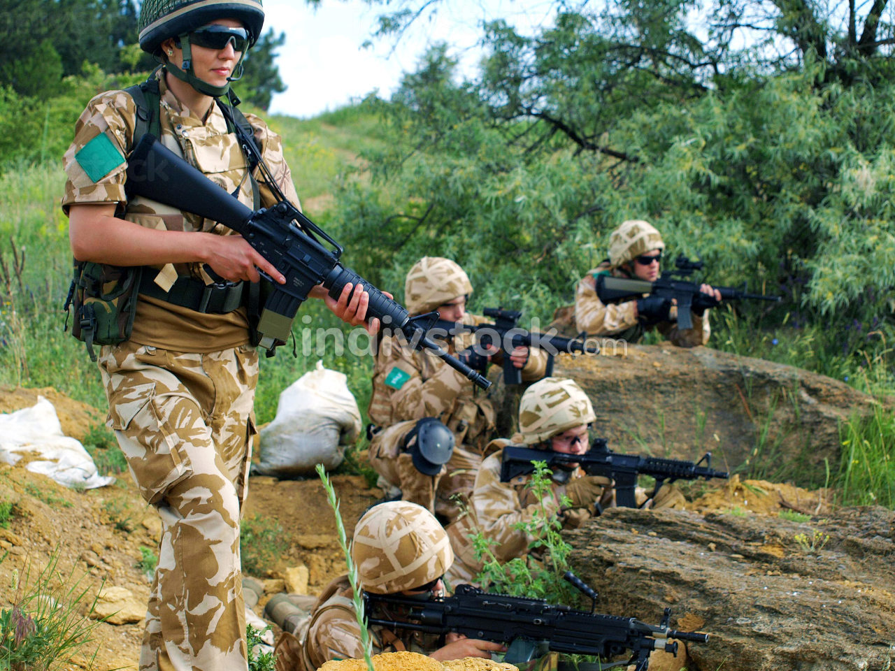 group of british soldiers in action