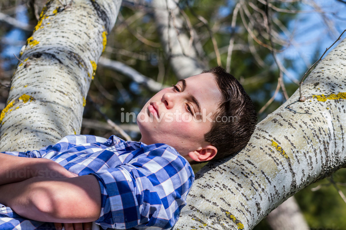 Handsome.A young boy dressed in western attire, outdoor park, su