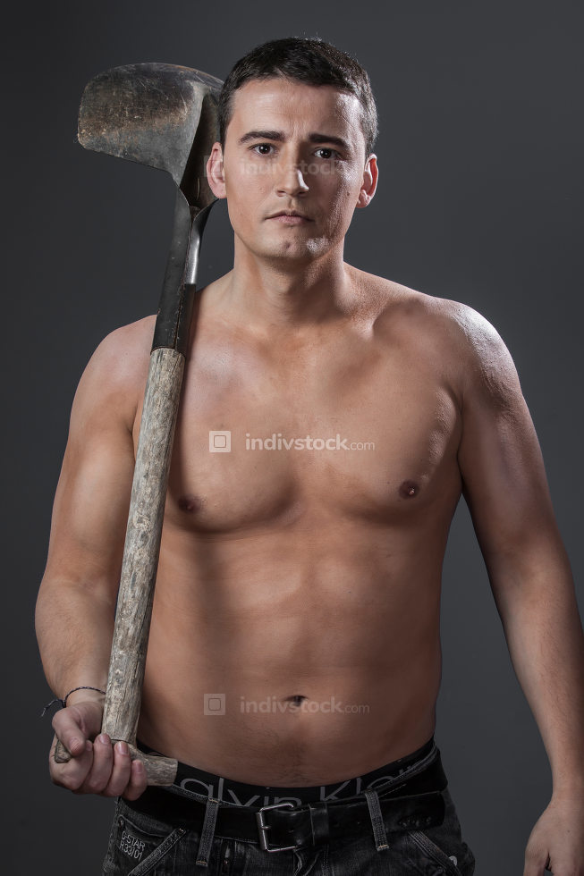 Industrial, Male worker holding a shovel, sexy builder