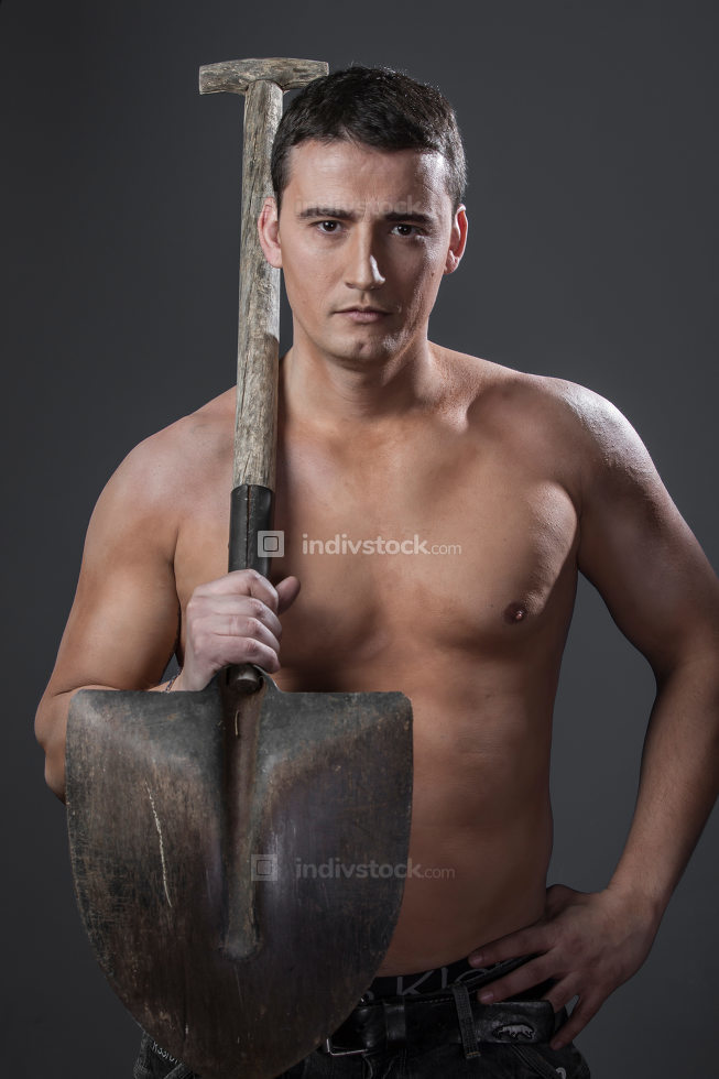 Labour, Male worker holding a shovel, sexy builder