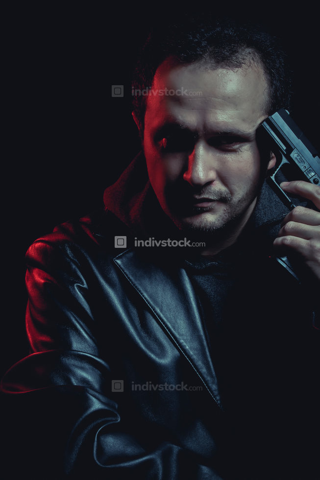 man with a gun on his head, suicide concept