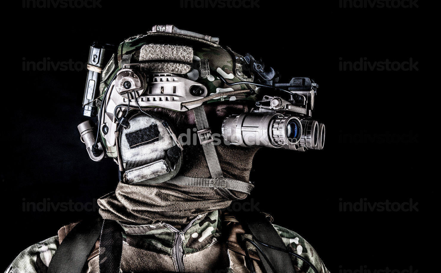 Modern army special forces soldier, anti terrorist squad fighter, elite commando warrior wearing mask, using four lenses night vision goggles in low light conditions, studio shoot on black background