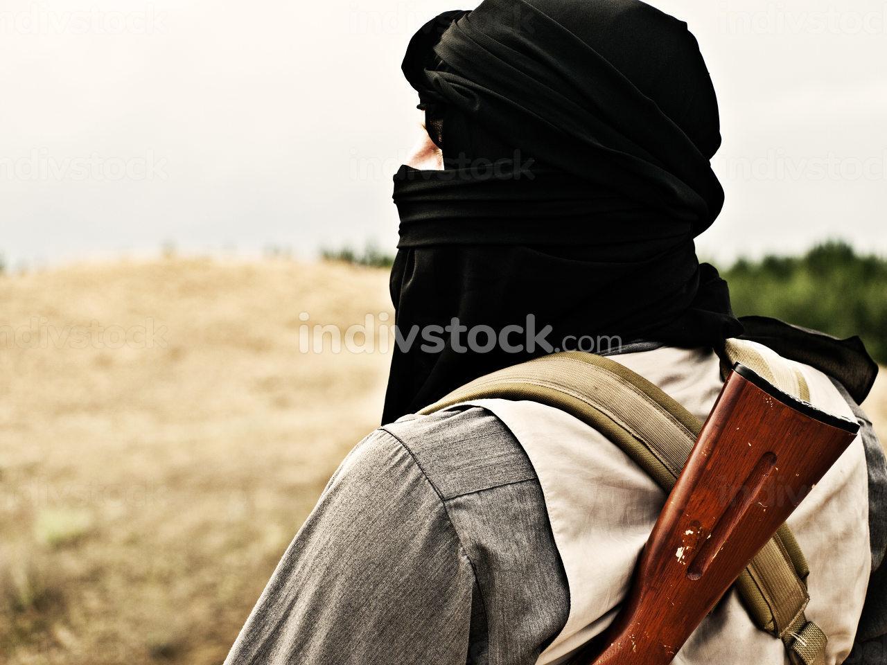Muslim rebel with automatic rifle and machine-gun belt
