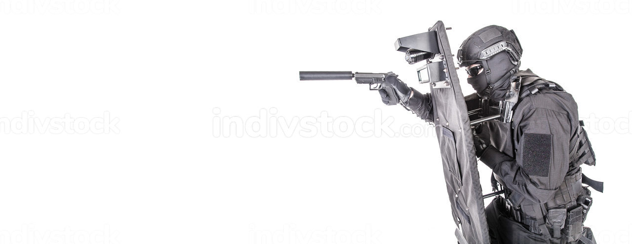 Police special operations and counter-terrorism team, SWAT officer in black uniform, mask and helmet, hiding behind ballistic shield and aiming with pistol, studio shoot, isolated on white background
