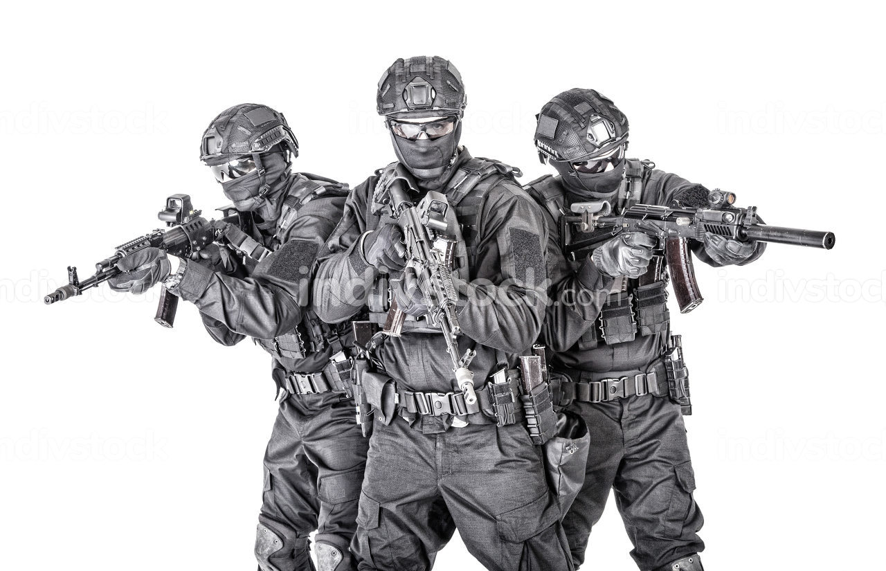 Police special operations tactical team, special security operations group fighters in black blank uniforms and full ammunition, armed with assault rifles, studio shoot, isolated on white background