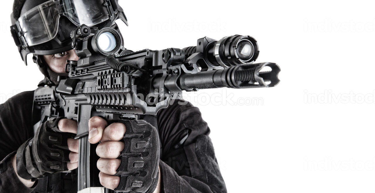 Police tactical group shooter, SWAT, anti-terror team member in black uniform and helmet aiming assault rifle with optical sight and flashlight, shooting with service weapon close up isolated portrait